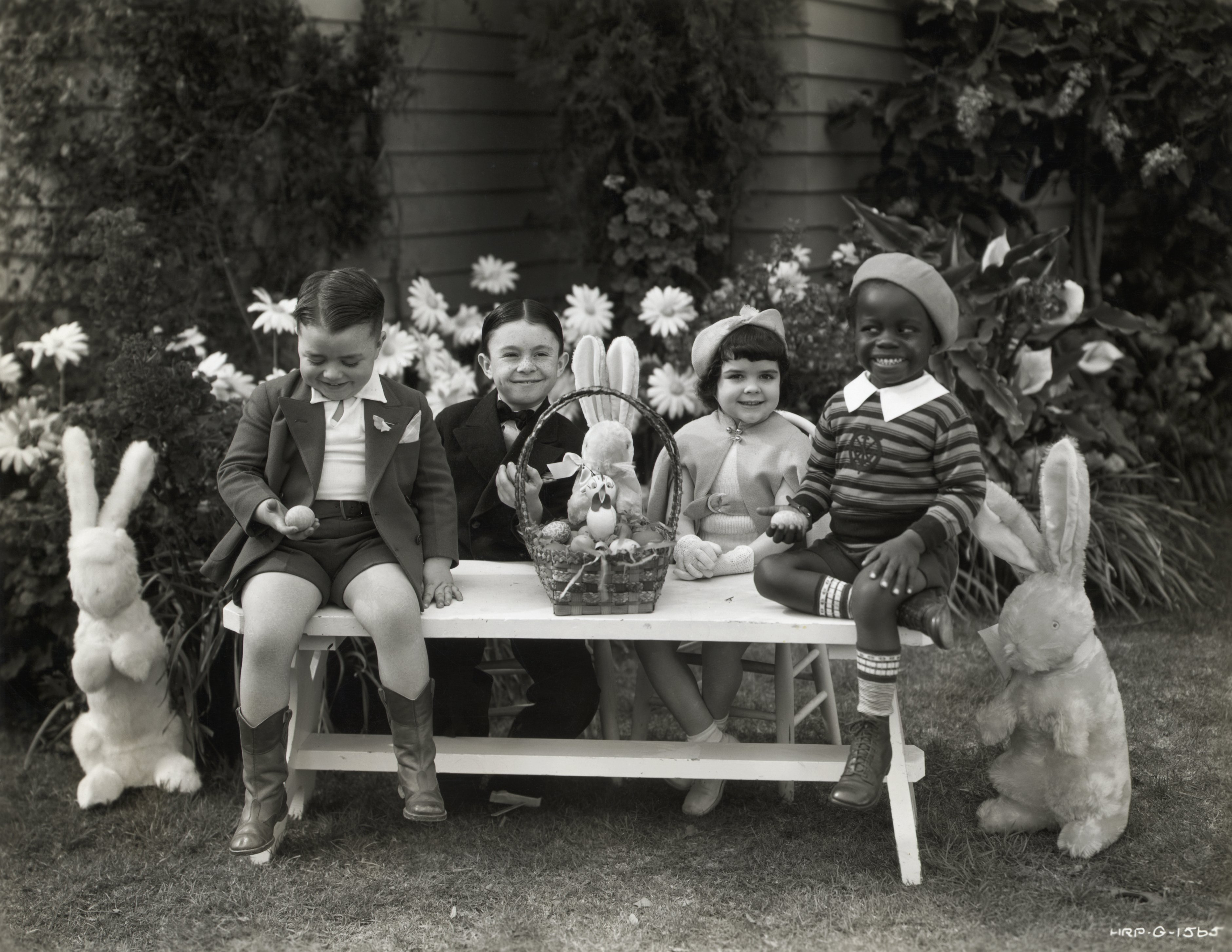 """""""Our Gang"""" kids celebrating Easter outdoors 