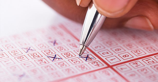A person filling out lottery tickets.   Source: Shutterstock