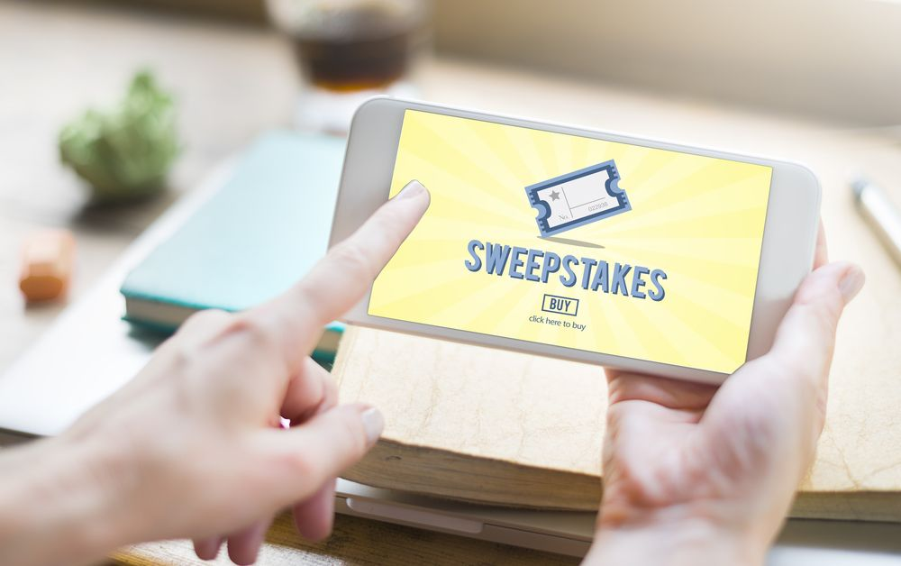 An online sweepstakes application open on a phone.   Source: Shutterstock