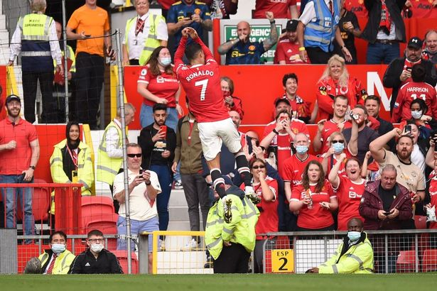 Manchester United's Portuguese striker Cristiano Ronaldo celebrates after scoring the opening goal of the English Premier League football match between Manchester United and Newcastle at Old Trafford in Manchester, north west England, on September 11, 2021.