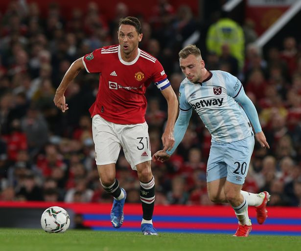 Nemanja Matic of Manchester United in action with Jarrod Bowen of West Ham United during the Carabao Cup Third Round match between Manchester United and West Ham United at Old Trafford on September 22, 2021 in Manchester, England.