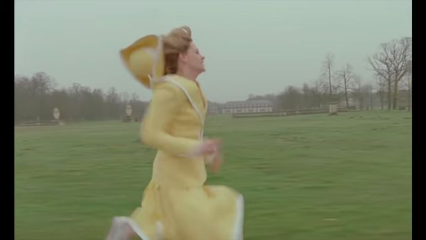 Diana is seen running around the palace grounds, then rushing down the halls