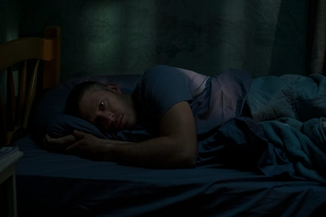 """A former altar boy who's now an atheist, Riley (Zach Gilford) is haunted by the sins of his past in """"Midnight Mass."""""""
