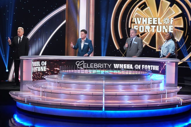 """""""Celebrity Wheel of Fortune"""" host Pat Sajak, left, joins contestants Donny Osmond, Jeff Garlin and Amber Riley on the Oct. 10 episode of the celebrity edition of the popular game show."""