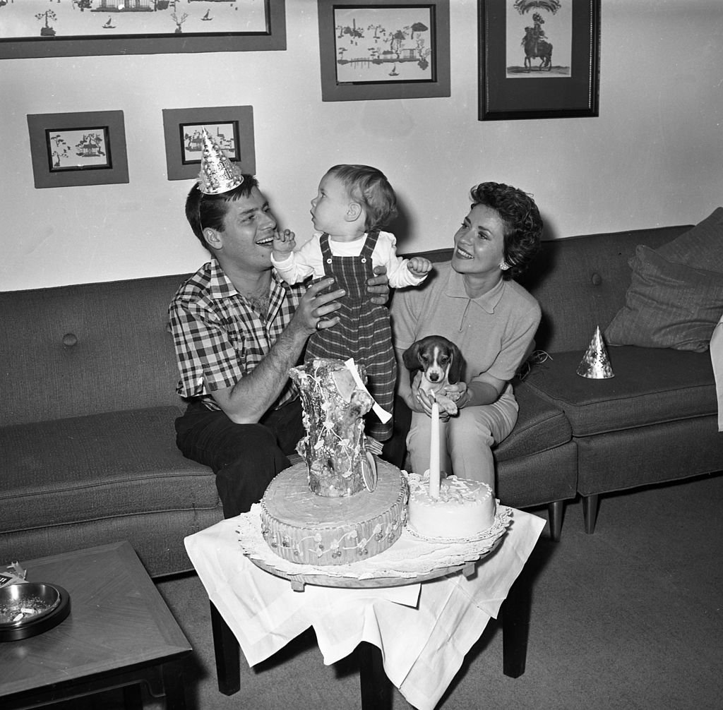 Jerry Lewis backstage at the RKO Palace Theater with his wife Patti Palmer and son Scott Anthony Lewis on Broadway on February 7, 1957 in New York |