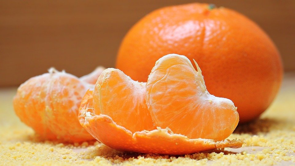 Peeled oranges on a table.   Source: Pixabay