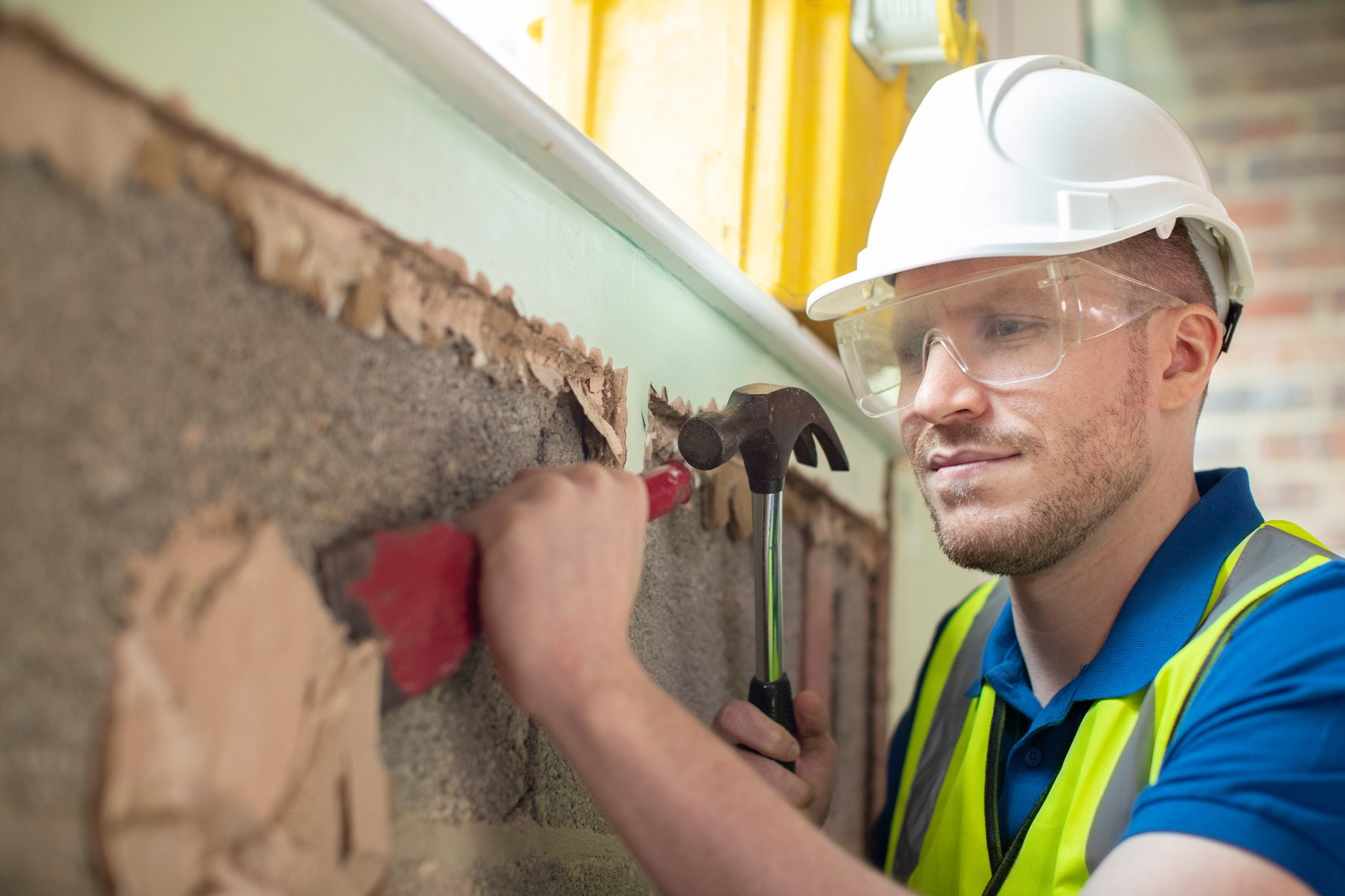 John was knocking down walls at work. |