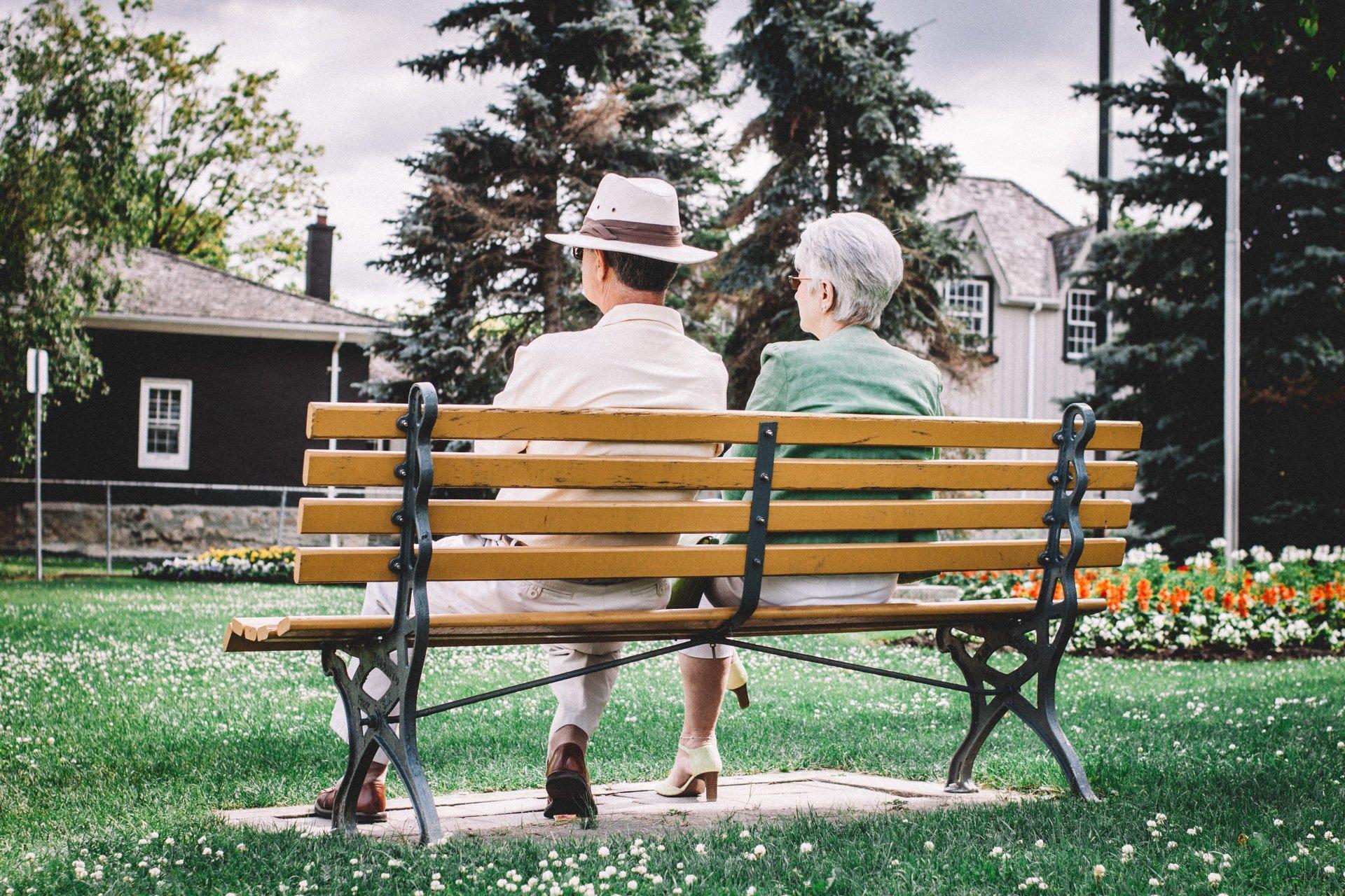 Elderly couple sitting on a bench   Source: Unsplash