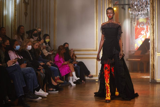 A model presents a creation for Rochas womenswear spring/summer 2022 collection during Paris Fashion Week.