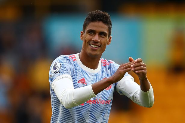 Raphael Varane of Manchester United applauds the supporters following the Premier League match between Wolverhampton Wanderers and Manchester United at Molineux on August 29, 2021 in Wolverhampton, England.