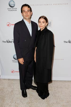 Ashley Olsen stepped out on a red carpet for the first time in two years with boyfriend Louis Eisner to attend a YES gala founded by his father.
