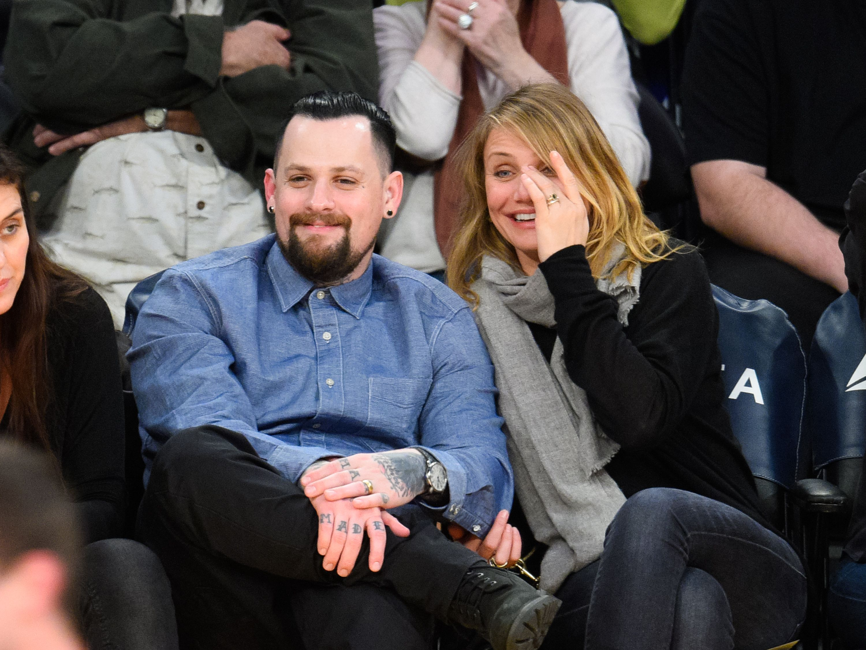 Benji Madden and Cameron Diaz at a basketball game held at Staples Center on January 27, 2015, in Los Angeles, California | Photo: Noel Vasquez/GC Images/Getty Images