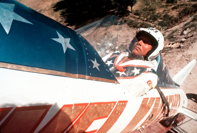 """In this Sept. 8, 1974, file photo, Evel Knievel sits in the steam-powered rocket motorcycle that he hopes will take him across Snake River Canyon in Twin Falls, Idaho. Knievel's son is suing Walt Disney Co. and Pixar over """"Toy Story 4"""" daredevil Duke Caboom, accusing the moviemakers of improperly basing the character on Knievel."""