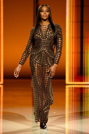 Naomi Campbell and Carla Bruni returned to the Paris runway to feverish screams to help Olivier Rousteing celebrate his 10-year anniversary at the creative helm of Balmain.