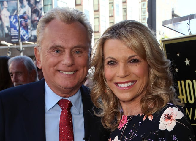 """Pat Sajak, left, and Vanna White, who recently extended their syndicated """"Wheel of Fortune"""" deals through 2024, return Sunday for Season 2 of primetime """"Celebrity Wheel of Fortune"""" on ABC."""