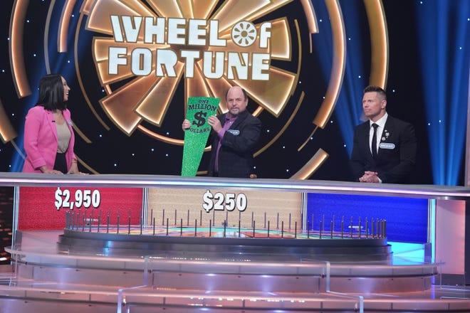 "Cheryl Burke, left, Jason Alexander and Michael ""The Miz"" Mizanin kick off Season 2 of ABC's ""Celebrity Wheel of Fortune"" on Sept. 26."