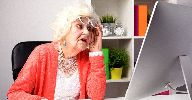 An elderly woman looking at the computer monitor.   Source: Shutterstock
