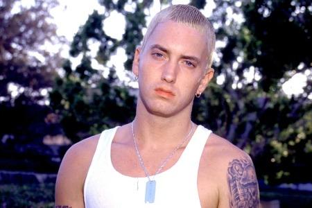 In Detroit, Eminem opens Mom's Spaghetti Restaurant.