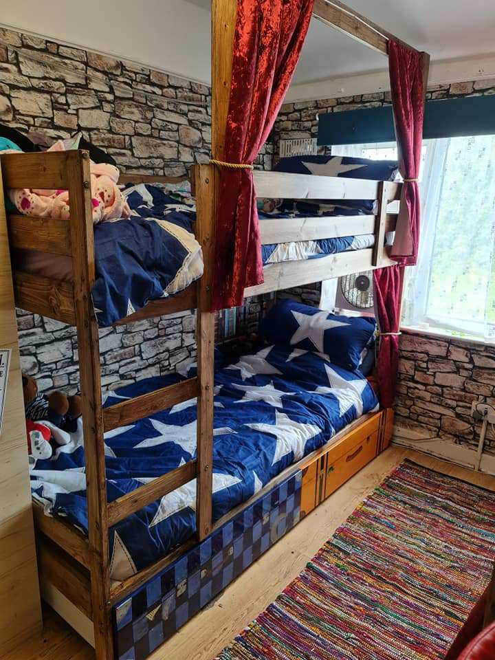 She turned the room into a Harry Potter dormitory and added drapes to the bunk beds