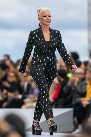 """Actress Helen Mirren walks the runway during the """"Le Defile L'Oreal Paris 2021"""" Womenswear Spring/Summer 2022 show as part of Paris Fashion Week on October 03, 2021 in Paris, France."""