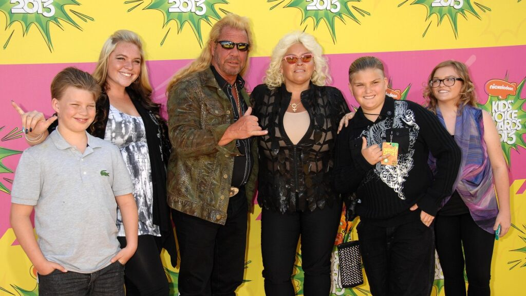 Dog the bounty hunter and his late wife Beth Chapman pose with the couple's four children on the red carpet