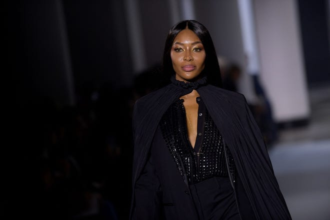 British model Naomi Campbell presents a creation for Lanvin during the Women's Spring-Summer 2022 Ready-to-Wear collection fashion show at The Salle Pleyel, in Paris, as part of the Paris Fashion Week, on October 3, 2021.